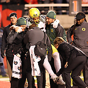 Duck TE Pharaoh Brown was injured in the 4th Quarter as QB Marcus Mariota scored a touchdown.  The University of Oregon Ducks defeated the University of Utah Utes 51-27 at Rice-Eccles Stadium, Salt Lake City, Utah. Photo by Barry Markowitz, 11/8/14, 8pm