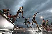 Jul 25, 2019; Des Moines, IA, USA; Runners race over the water jump in a steeplechasee heat during the USATF Championships at Drake Stadium.