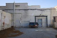 Dumpster at back of building, Riverside, California.