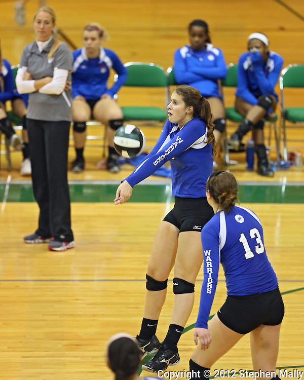 Washington's Danielle Franklin (10) digs a ball during the MVC Volleyball Tournament Championship game between the Hempstead Mustangs and the Washington Warriors at Kennedy High School in Cedar Rapids on Saturday October 13, 2012. Hempstead defeated Washington 25-21 25-19.