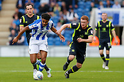 Colchester United's Mikaël Mandron(19) Carlisle United's James Brown  battles for possession during the EFL Sky Bet League 2 match between Colchester United and Carlisle United at the Weston Homes Community Stadium, Colchester, England on 14 October 2017. Photo by Phil Chaplin