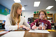 Reading Partners Regional Site Coordinator Claire Bleymaier of San Jose tutors third grader Isabella Ruiz, 8, during the Reading Partners tutoring program at Rose Elementary School in Milpitas, California, on December 8, 2014. (Stan Olszewski/SOSKIphoto)