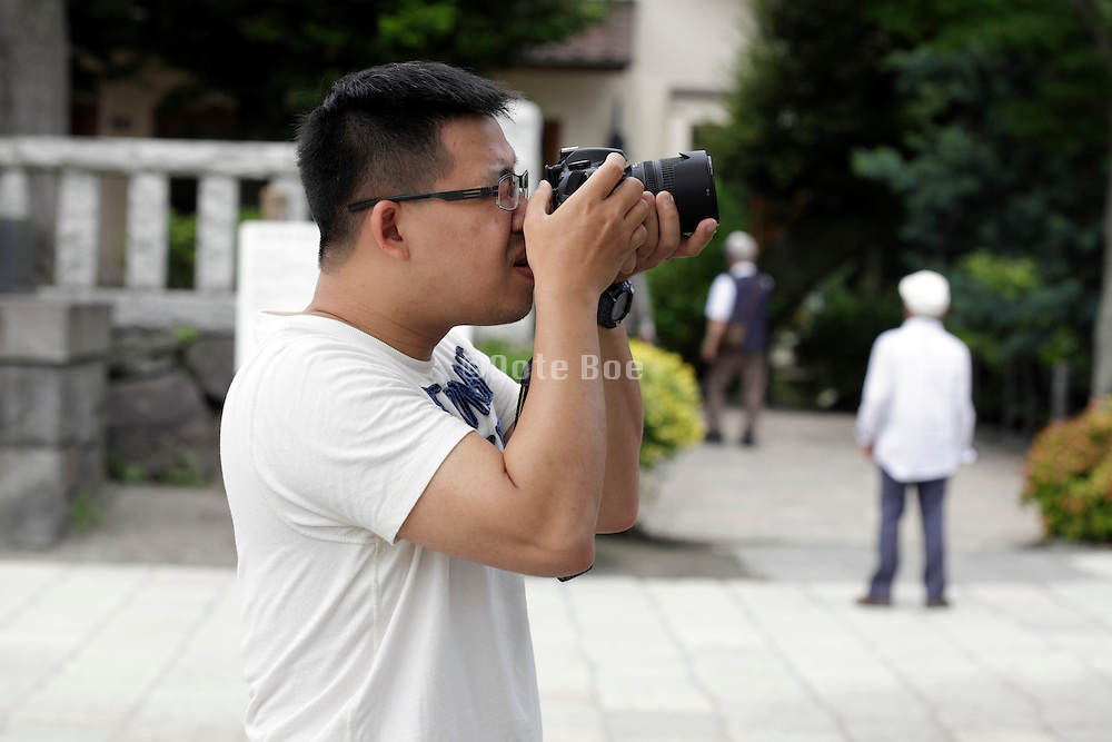 young adult male taking pictures