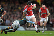Photo © TOM DWYER / SECONDS LEFT IMAGES 2010 - Rugby Union - Invesco Perpetual Series - Wales v South Africa - 13/11/10 - Wales' Tom Shanklin on the break tackled by South Africa's Gio Aplon - at Millennium Stadium Cardiff Wales UK -  All rights reserved