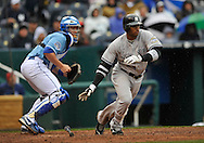 April 12, 2009:  Second basemen Robinson Cano #24 of the New York Yankees drives a base hit to right field during a game against the Kansas City Royals at Kauffman Stadium in Kansas City, Missouri.  The Royals defeated the Yankees 6-4.