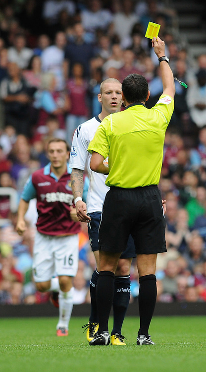 21.08.2010, Boleyn Ground, London, ENG, PL, West Ham United vs Bolton Wanderers, im Bild Grtar Steinsson gets a yellow card for a foul against Hrita Ilunga..West Ham vs Bolton.English Championship. EXPA Pictures © 2010, PhotoCredit: EXPA/ IPS/ Daniel Cawthorne +++++ ATTENTION - OUT OF ENGLAND/UK +++++ / SPORTIDA PHOTO AGENCY