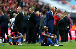 Crystal Palace Manager Alan Pardew consoles Wilfried Zaha and Yannick Bolasie of Crystal Palace after losing in the FA Cup Final - Mandatory by-line: Robbie Stephenson/JMP - 21/05/2016 - FOOTBALL - Wembley Stadium - London, England - Crystal Palace v Manchester United - The Emirates FA Cup Final