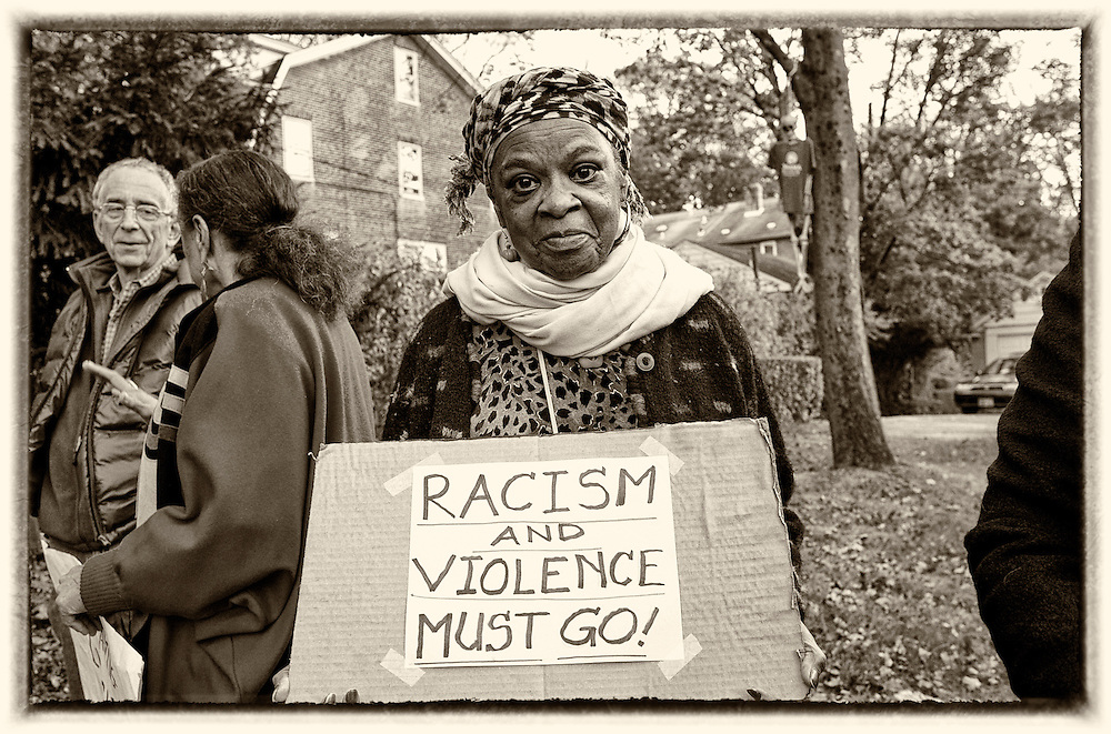 Betty Ann Wilson, 72, protesting an act of racism in Swarthmore, Pennsylvania. ( ED HILLE / Staff Photographer )