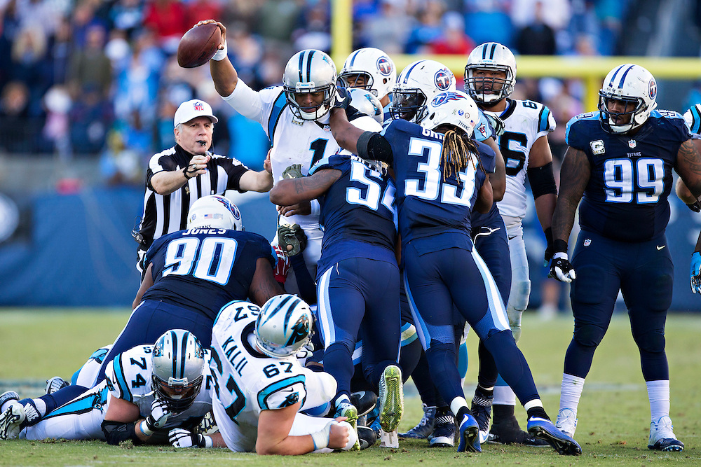 NASHVILLE, TN - NOVEMBER 15:  Cam Newton #1 of the Carolina Panthers reaches the ball out for a first down while being tackled by DaQuan Jones #90, Avery Williamson #54 and Michael Griffin #33 of the Tennessee Titans at Nissan Stadium on November 15, 2015 in Nashville, Tennessee.  (Photo by Wesley Hitt/Getty Images) *** Local Caption *** Cam Newton; DaQuan Jones; Avery Williamson; Michael Griffin