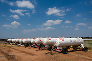 Anhydrous ammonia tanks lined up in a row at a farmer's co-op in Lowel, Oklahoma