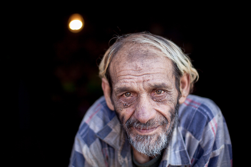 """Portrait of Stephan nicknamed """"Longa"""" in his home at the Roma settlement located at """"Budulovska Street"""" in Moldava nad Bodvou about 30 km from Kosice. About half a year later the little house of Stephan was empty, he passed away in the end of 2014 by a serious illness."""