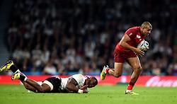 Jonathan Joseph of England takes on the Fiji defence - Mandatory byline: Patrick Khachfe/JMP - 07966 386802 - 18/09/2015 - RUGBY UNION - Twickenham Stadium - London, England - England v Fiji - Rugby World Cup 2015 Pool A.