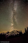By 2AM the Milky Way is right over the summit of Mt Rainier and looks as though it is coming out of the volcano. Three parties climb the north side of the volcano and at least three more are climbing the ridge along the east side.