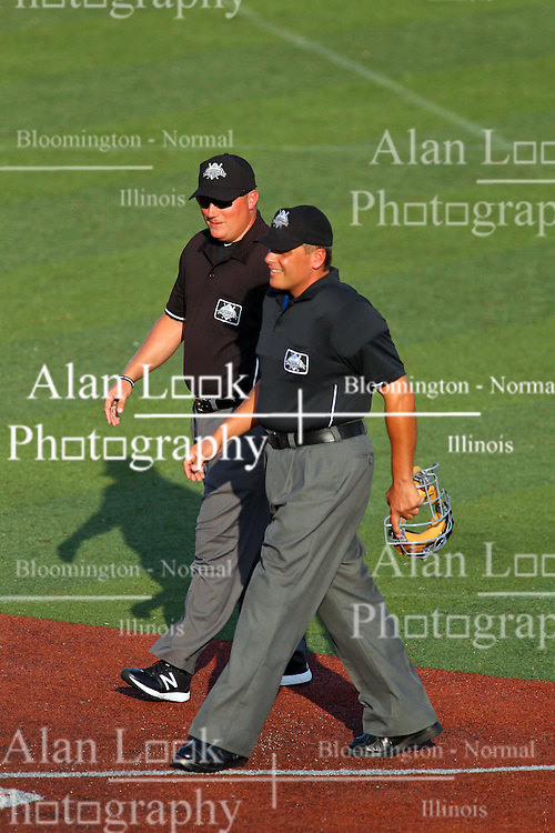 29 July 2016: Umpires Stacey Dunbar and Mike Fichter during a Frontier League Baseball game between the Lake Erie Crushers and the Normal CornBelters at Corn Crib Stadium on the campus of Heartland Community College in Normal Illinois