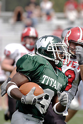 09 September 2006  Titan Marcus Dunlop turns the corner on Comet Ryan Adams..In the first ever football competition between the Olivet Comets and the Illinois Wesleyan Titans, the Titans strut off the field with a 21- 6 victory. .Game action took place at Wilder Field on the campus of Illinois Wesleyan University in Bloomington Illinois.