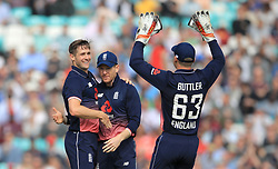 England's Chris Woakes celebrates taking the wicket of West Indies' Marion Samuels for 1 during the Fourth Royal London One Day International at the Kia Oval, London.