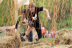 ©Licensed to London News Pictures. 13/05/2012.Boughton House, Northants. Tough Mudders tackle electro shock therepy during 12 mile endurance challenge..Photo credit: Steven Prouse/ LNP