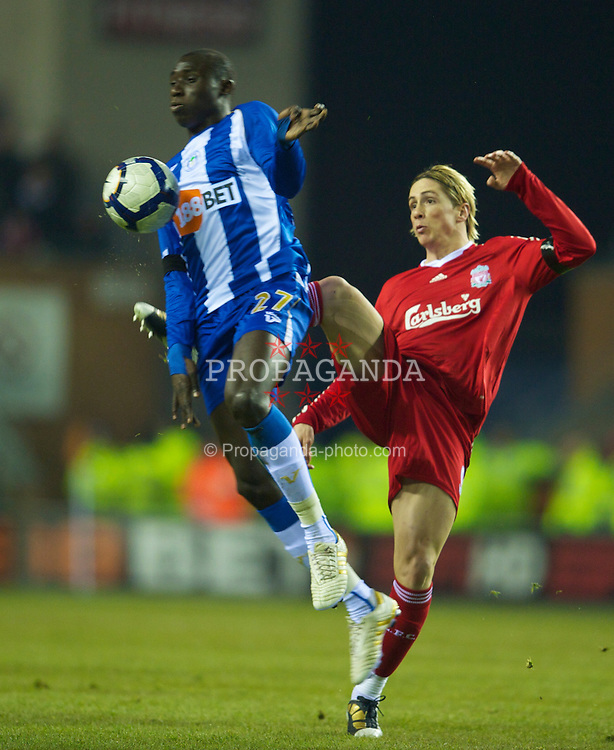 WIGAN, ENGLAND - Monday, March 8, 2010: Liverpool's Fernando Torres and Wigan Athletic's Mohamed Diame during the Premiership match at the DW Stadium. (Photo by David Rawcliffe/Propaganda)