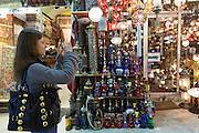 Western tourist using smartphone to photograph The Grand Bazaar, Kapalicarsi, great market, Beyazi, Istanbul, Turkey
