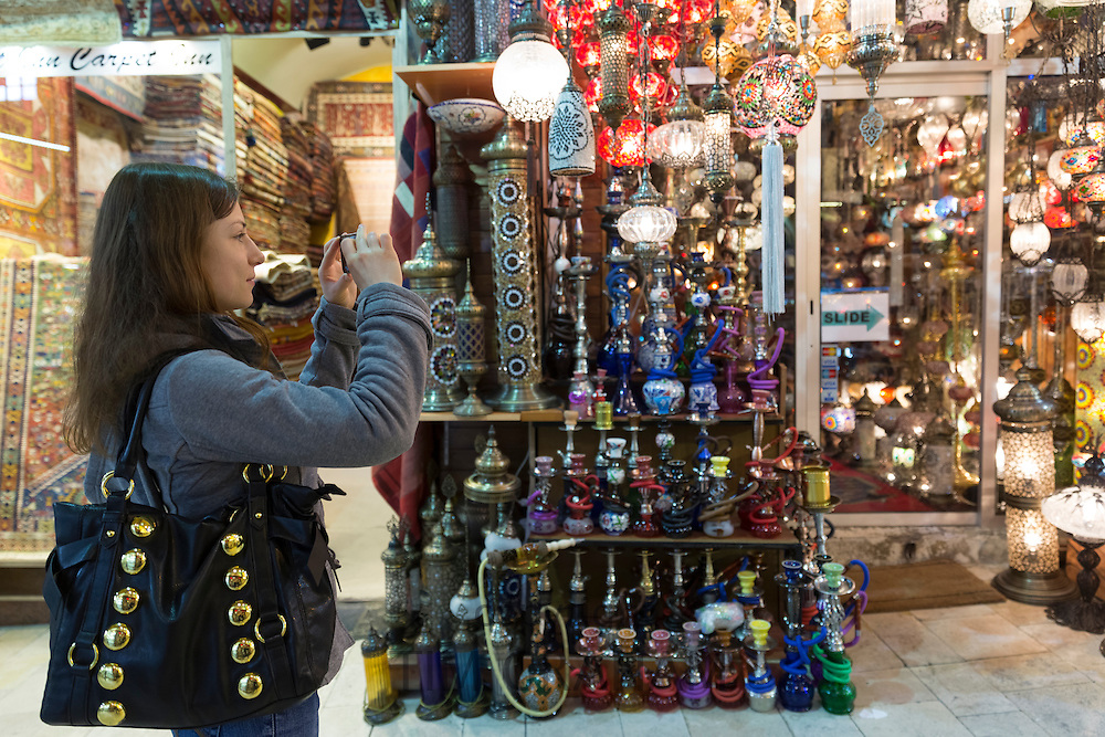 Western tourist using smartphone to photograph The Grand Bazaar, Kapalicarsi, great market, Beyazi, Istanbul, Turkey