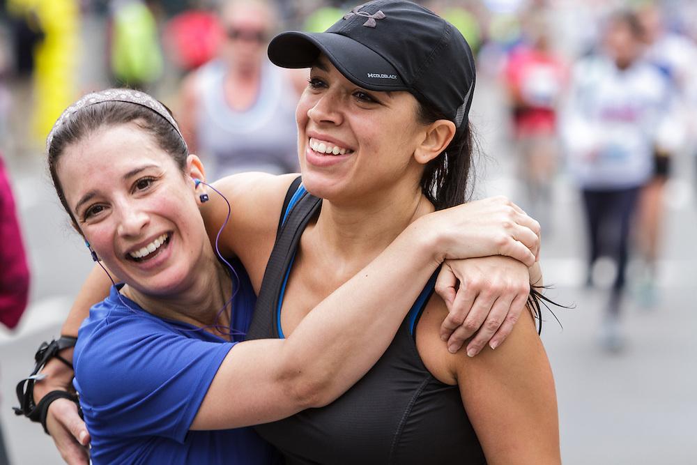 Tufts Health Plan 10K for Women, happy finishers hug