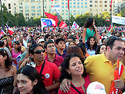 As Michelle Bachelet was elected the first woman to be Chile`s president thousands gathered in front of La Moneda Presidential Palace to celebrate.                Santiago, Chile March 12 2006