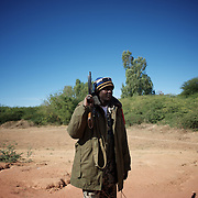 January 21, 2013 - Diabaly, Mali: A Mali army man takes guard on the road outside Diabaly, a day after the government troops regain control of the city. Diabaly was under islamist militants control since the 14th of January.<br />