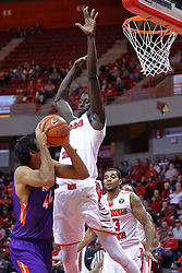 "29 December 2016: David Howard hesitates to get a shot past the towering Daouda ""David"" Ndiaye (4) during an NCAA  MVC (Missouri Valley conference) mens basketball game between the Evansville Purple Aces the Illinois State Redbirds in  Redbird Arena, Normal IL"