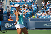 Ashleigh Barty (AUS) hits a forehand to Svetlana Kuznetsova (RUS) during the Western and Southern Open tennis tournament at Lindner Family Tennis Center, Saturday, Aug 17, 2019, in Mason, OH. (Jason Whitman/Image of Sport)