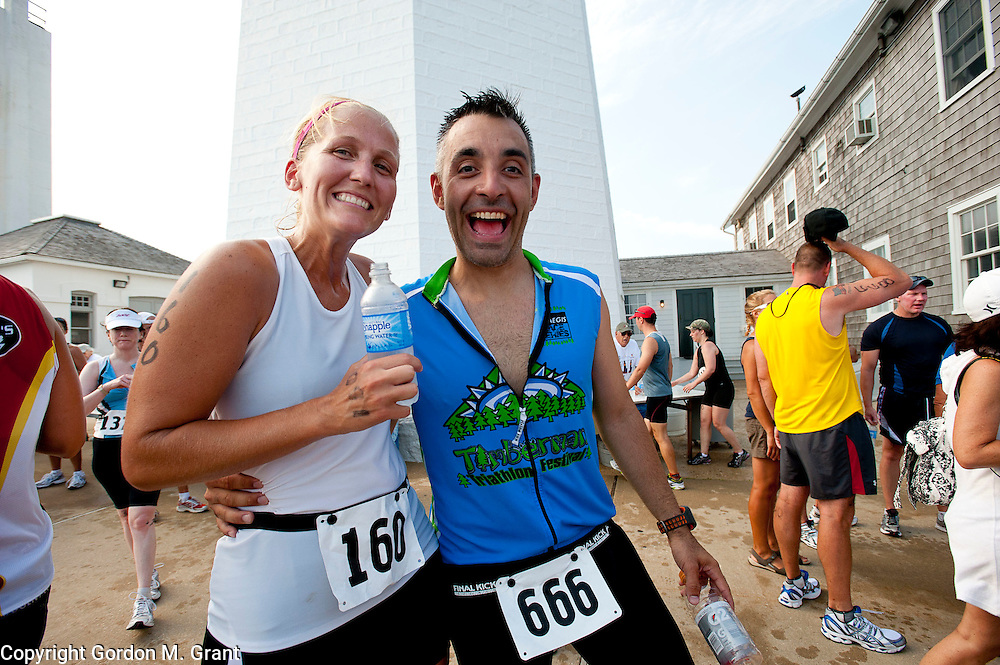Kate and Joe Lombardo of East Hampton find each other at the finish line of the Montauk Point Lighthouse Sprint Triathlon in Montauk. (July 18, 2010)