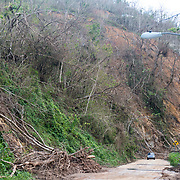 OCTOBER 13 - UTUADO, PUERTO RICO - <br /> Debris and mud from a mud slide over a road in the Barrio Salto Arriba after the path of  Hurricane Maria. <br /> (Photo by Angel Valentin/Freelance)