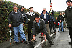 Members of the Dunmanway Road Bowling Club Co Cork watching out for the bullet during the Novice 1 final between John Hurley (Munster) and Niall Smith (Ulster ).at the All Ireland Road Bowling Championships in Aghagower on sunday...Pic Conor McKeown.
