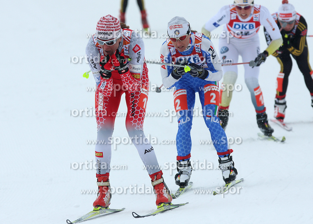 Petra Majdic of Slovenia leading infornt of Arianna Follis of Italy at Ladies` Sprint Free Quarterfinals Cross-country race at  FIS Nordic World Ski Championships Liberec 2008, on February 24, 2009, Vestec, Liberec, Czech Republic. (Photo by Vid Ponikvar / Sportida)
