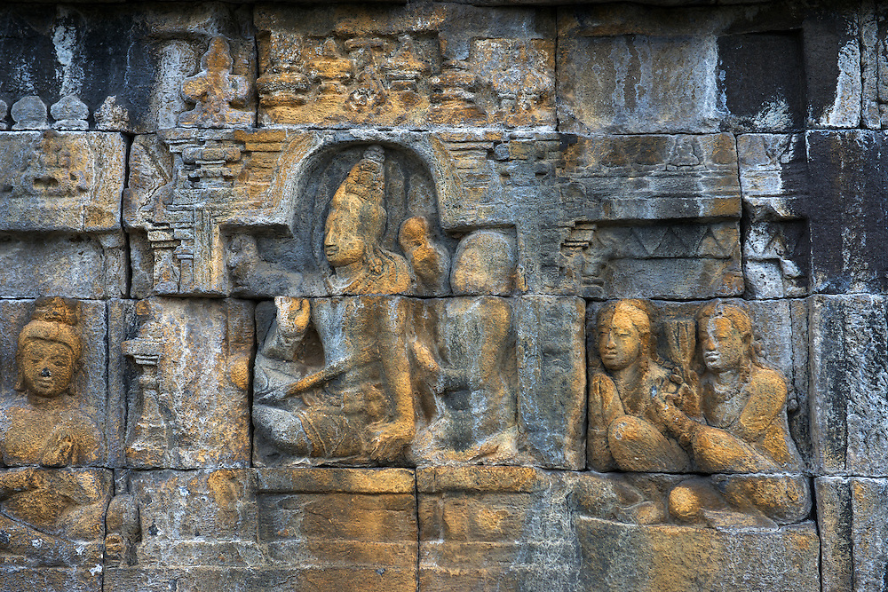Stone-carved panels depict the life and times of the Lord Buddha on the magnificent Borobodur,a 9th-century Mahayana Buddhist Temple. Waisak Day (Buddha's birthday) draws pilgrim monks from all over Asia.