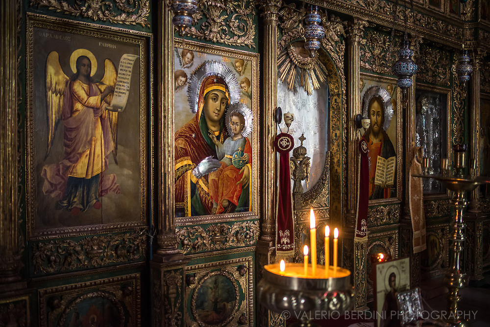 Icons lit by candle light in an Orthodox church of Jerusalem Old City.