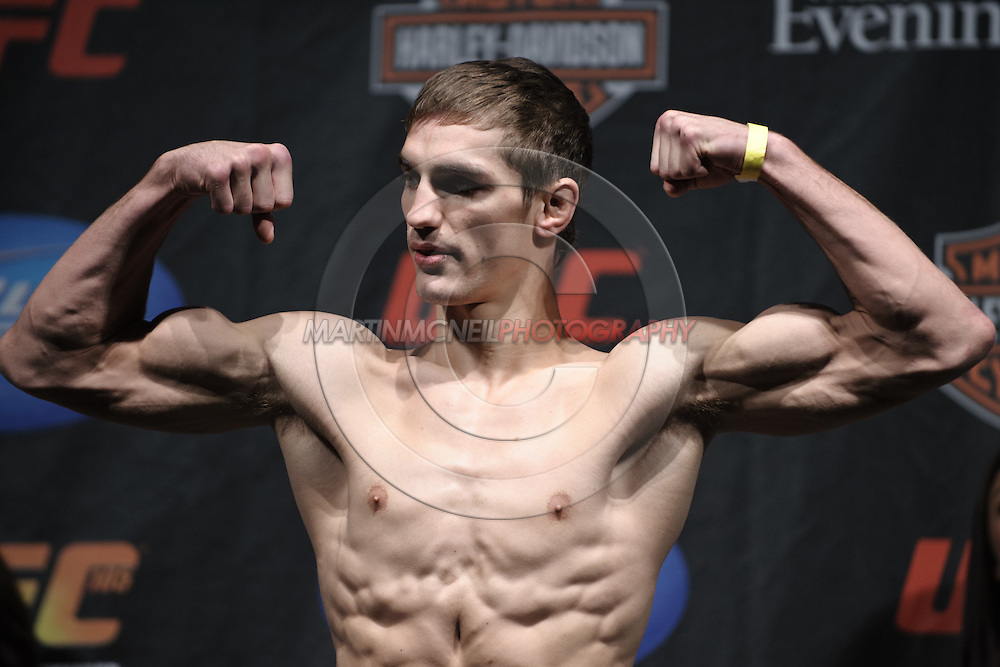 MANCHESTER, ENGLAND, NOVEMBER 13, 2009: John Hathaway poses on the scales during the weigh-ins for UFC 105 at the MEN Arena in Manchester, England on November 13, 2009.