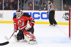 Jan 17; Newark, NJ, USA; New Jersey Devils goalie Martin Brodeur (30) makes a save during the first period of their game against the Winnipeg Jets at the Prudential Center.
