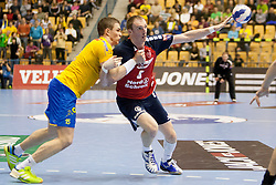 Vid Poteko of Celje PL and Holger Glandorf of SG Flensburg-Handewitt during handball match between RK Celje Pivovarna Lasko and SG Flensburg-Handewitt in the last sixteen of EHF Champions League 2013/14 on March 23, 2014 in Dvorana Zlatorog, Celje, Slovenia. Photo by Urban Urbanc / Sportida