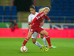CARDIFF, WALES - Tuesday, August 21, 2014: Wales' Nadia Lawrence in action against England during the FIFA Women's World Cup Canada 2015 Qualifying Group 6 match at the Cardiff City Stadium. (Pic by Ian Cook/Propaganda)