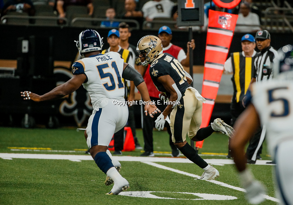 Aug 30, 2018; New Orleans, LA, USA; New Orleans Saints wide receiver Tre'Quan Smith (10) is pursued by Los Angeles Rams linebacker Ejuan Price (51) during the first half of a preseason game at the Mercedes-Benz Superdome. Mandatory Credit: Derick E. Hingle-USA TODAY Sports