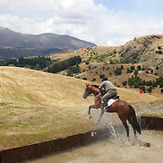 Wayne Harrex riding Dreamy As in action at the water jump during the Cross Country event at the Wakatipu One Day Horse Trials at the Pony Club grounds,  Queenstown, Otago, New Zealand. 15th January 2012. Photo Tim Clayton