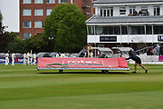 The covers come on as rain stops play during the opening day of the Specsavers County Champ Div 1 match between Somerset County Cricket Club and Hampshire County Cricket Club at the Cooper Associates County Ground, Taunton, United Kingdom on 11 May 2018. Picture by Graham Hunt.