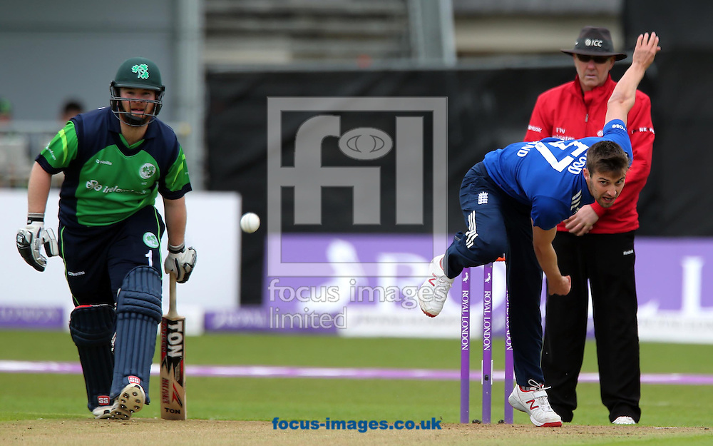 Mark Wood bowls for England watched by Paul Stirling of Ireland during the One Day International match at the Village, Malahide<br /> Picture by Lorraine O'Sullivan/Focus Images Ltd +353 872341584<br /> 08/05/2015