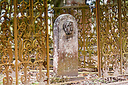 Old wrought iron fence in historic Magnolia Cemetery in Charleston, South Carolina.