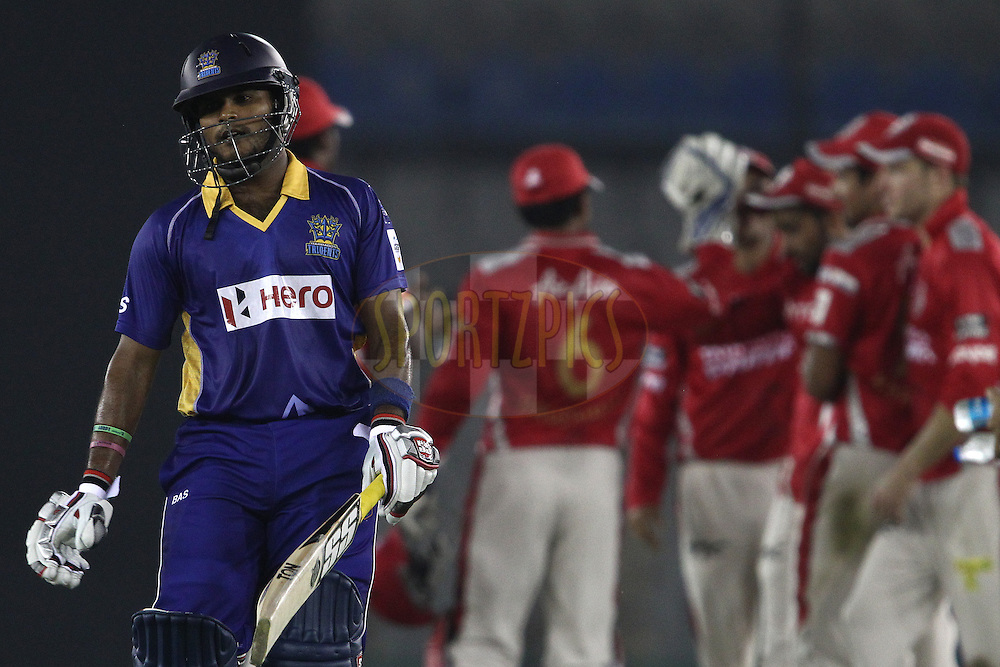 Dilshan Munaweera of the Barbados Tridents walks back to the dug out after losing his wicket during match 5 of the Oppo Champions League Twenty20 between the Kings XI Punjab and the Barbados Tridents held at the Punjab Cricket Association Stadium, Mohali, India on the 20th September 2014<br /> <br /> Photo by:  Shaun Roy / Sportzpics/ CLT20<br /> <br /> <br /> Image use is subject to the terms and conditions as laid out by the BCCI/ CLT20.  The terms and conditions can be downloaded here:<br /> <br /> http://sportzpics.photoshelter.com/gallery/CLT20-Image-Terms-and-Conditions-2014/G0000IfNJn535VPU/C0000QhhKadWcjYs