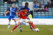 Coventry midfielder Jacob Murphy hold off Gillingham defender Adedeji Oshilaja during the Sky Bet League 1 match between Gillingham and Coventry City at the MEMS Priestfield Stadium, Gillingham, England on 2 April 2016. Photo by David Charbit.