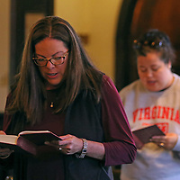 Aaron Stewart | BUY AT PHOTOS.DJOURNAL.COM<br /> All-Saints Episcopal Church member Martha Stephens recites a prayer along with the rest of the congregation at Saturday afternoon's service to honor and pray for those affected by Friday's attacks in Paris.