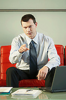 Stern Businessman Pointing portrait front view