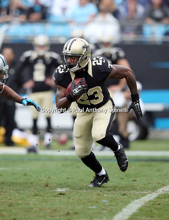 New Orleans Saints punt returner Marcus Murphy (23) returns a punt during the 2015 NFL week 3 regular season football game against the Carolina Panthers on Sunday, Sept. 27, 2015 in Charlotte, N.C. The Panthers won the game 27-22. (©Paul Anthony Spinelli)