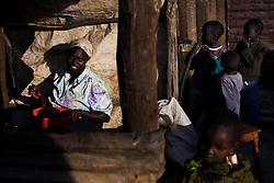 A woman prepares a meager supper for her family at an IDP camp in Burnt Forest. Four months election violence erupted in Kenya there are still some 300,000 people displaced, half of which are living in IDP camps. The violence was centered in the Rift Valley, Kenya's fertile bread basket.  Due to the violence and displacement many Kenya farmers have been unable to work their land for 4 months, leading to worries that Kenya will face severe food shortages by the end of the year.